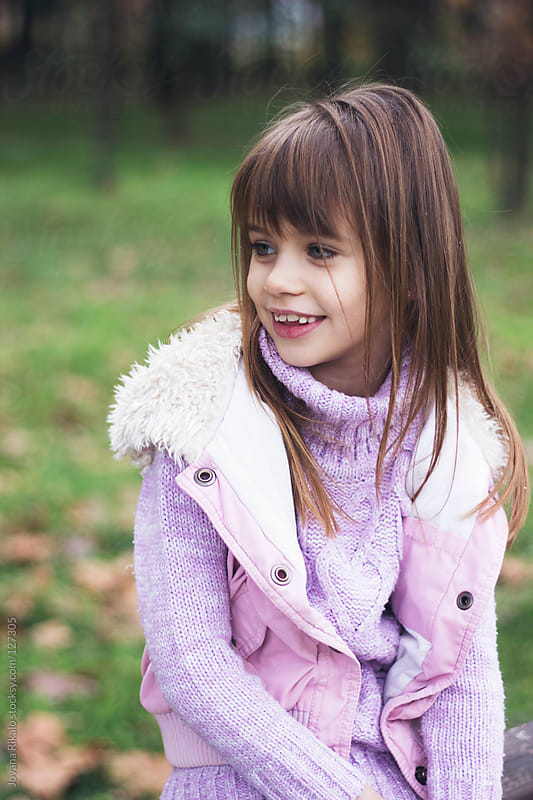 Portrait of a cute little girl smiling by Jovana Rikalo for Stocksy United