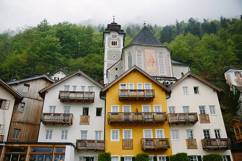 Building exterior of countryside houses and church in mountains by Andrey Pavlov for Stocksy United