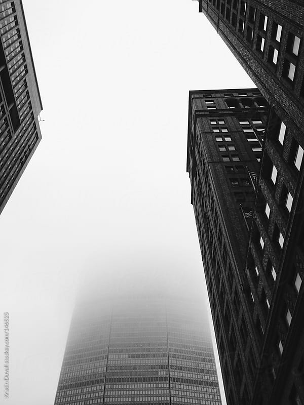Fog obsuring building. New York City. by Kristin Duvall for Stocksy United