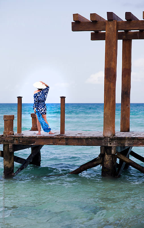 Woman In Blue Dress Relaxes On Dock In Mexico by Sara Remington for Stocksy United