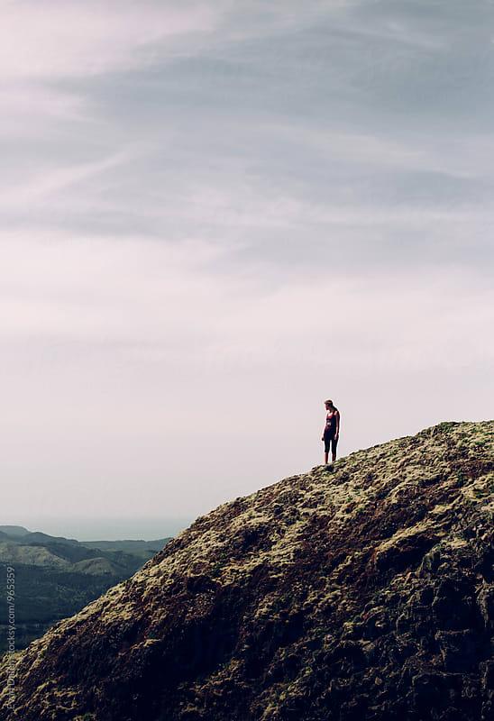 Woman On Mountain Ridge by Evan Dalen for Stocksy United