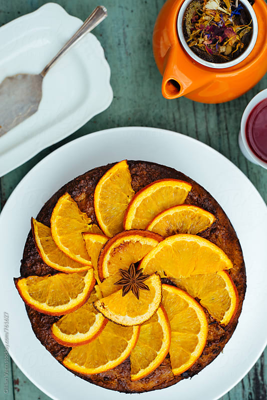 gluten free orange and almond cake with herbal tea by Gillian Vann for Stocksy United
