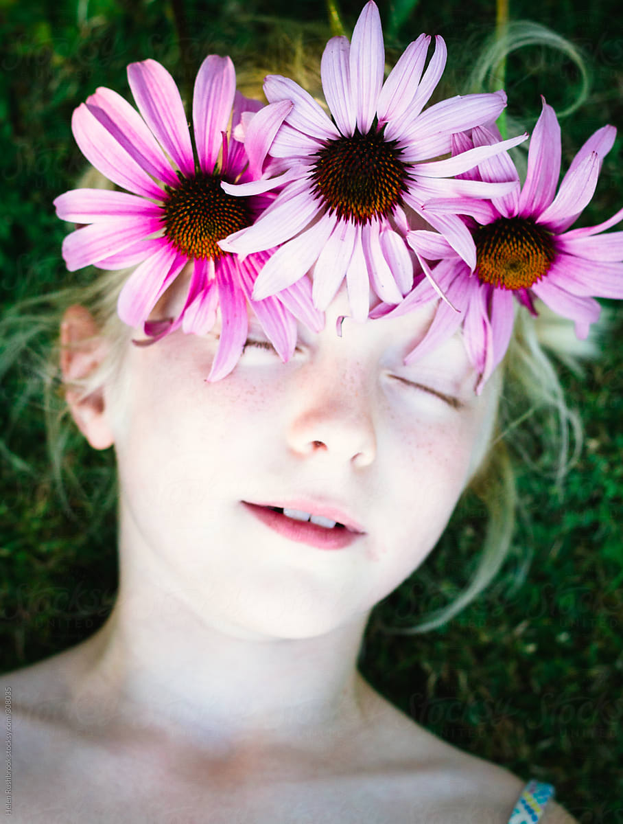 A Little Girl With A Crown Of Pink Flowers Her Eyes Closed