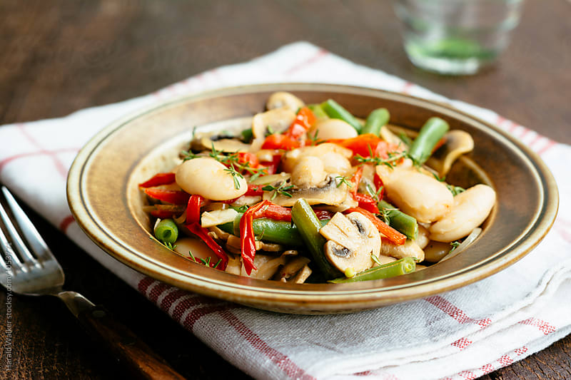 Warm Bean and Mushrooms Salad by Harald Walker for Stocksy United