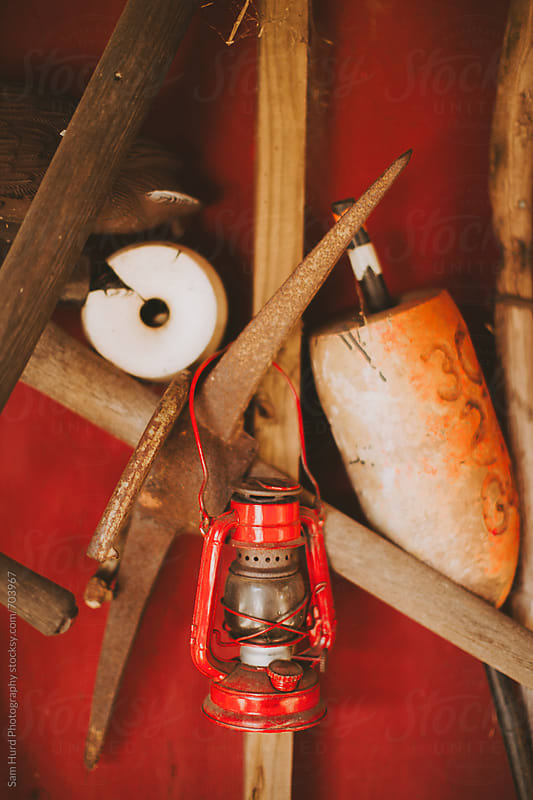 red lantern in the barn by Sam Hurd Photography for Stocksy United