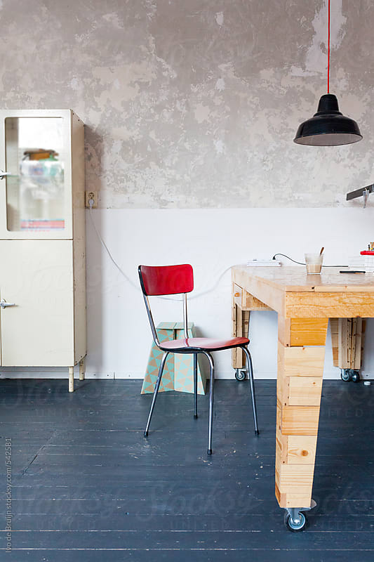 Photo of a wooden desk in a hip small office by Ivo de Bruijn for Stocksy United
