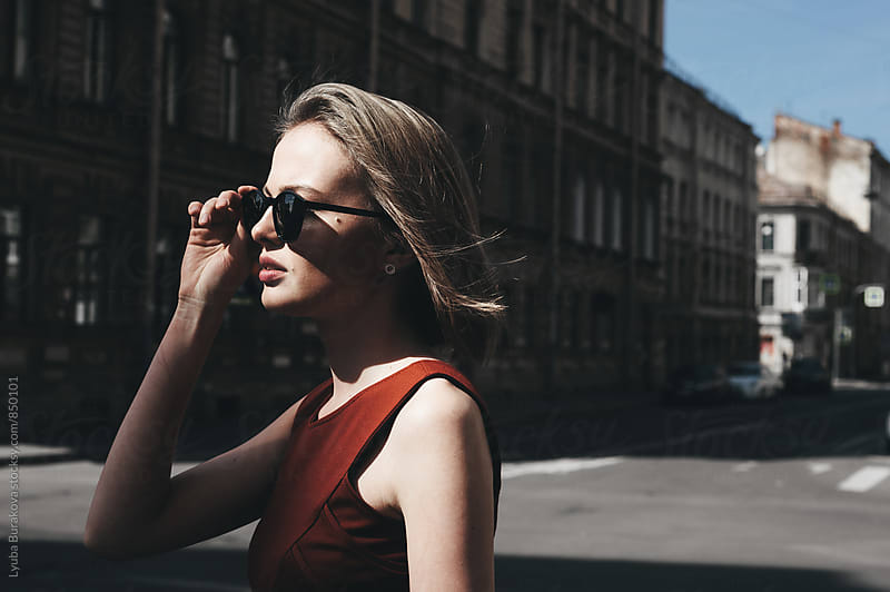 Young woman wearing sunglasses by Liubov Burakova for Stocksy United