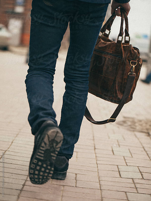 Legs of stylish man on pavement by T-REX & Flower for Stocksy United