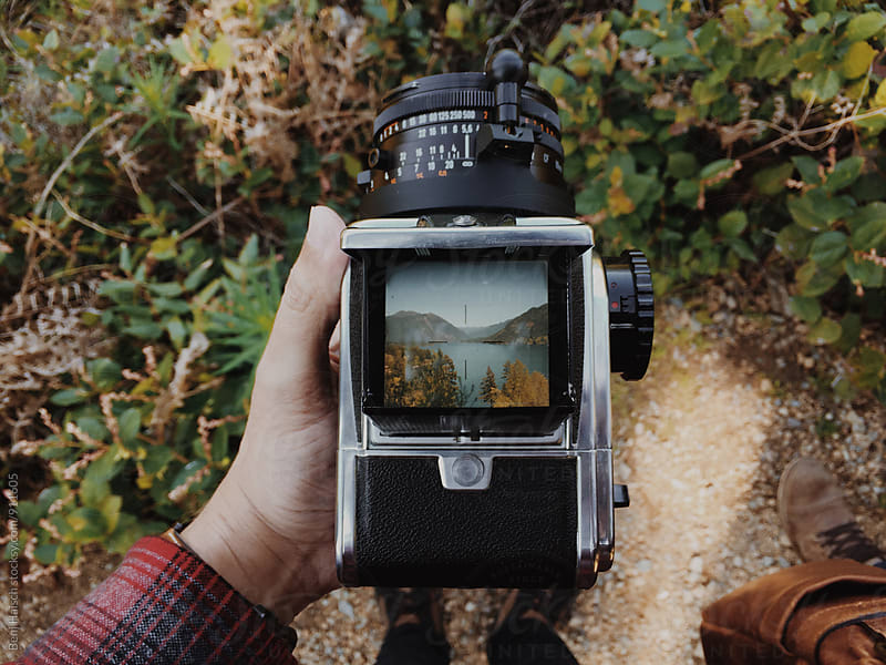 Man Holding a Vintage Film Camera by Benj Haisch for Stocksy United
