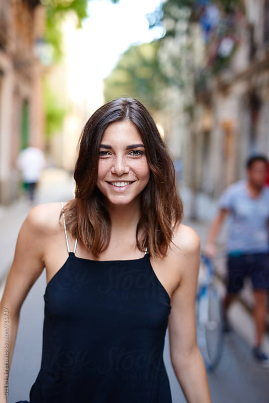 smiling woman walking around the city by Guille Faingold for Stocksy United