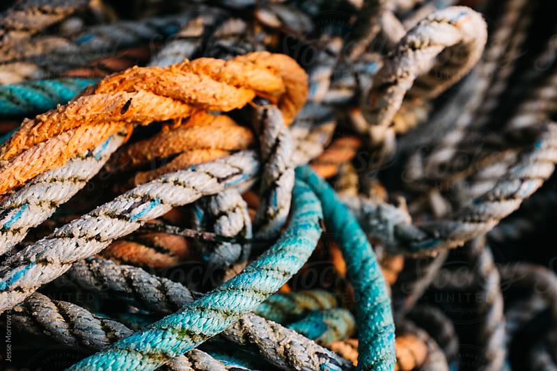 pile of knotted rope on beach  by Jesse Morrow for Stocksy United