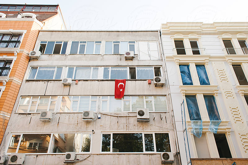 Turkish Flag Hanging from a Building by Caleb Thal for Stocksy United