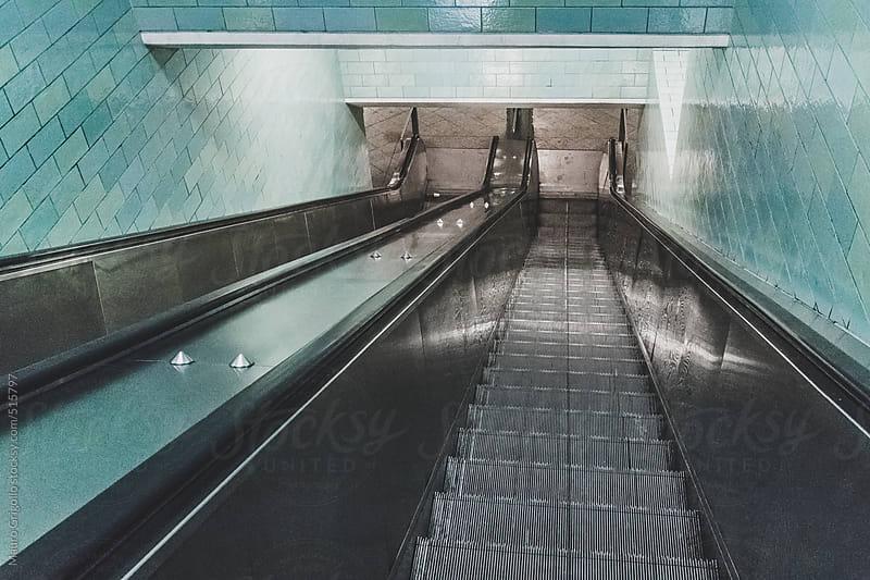 Escalator inside a train station by Mauro Grigollo for Stocksy United