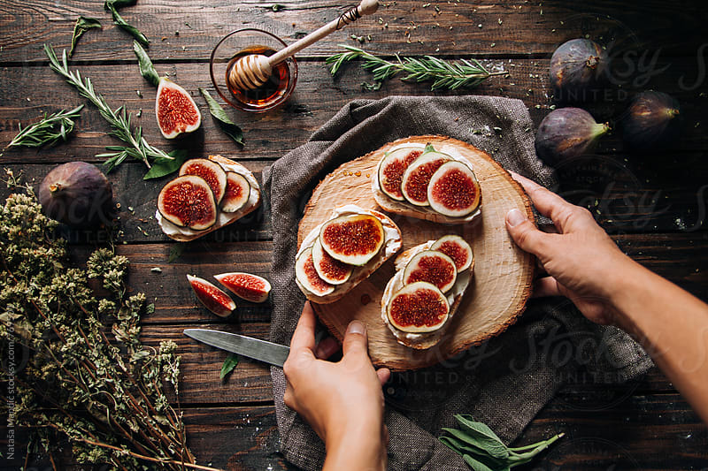 Crostini with cheese and figs by Nataša Mandić for Stocksy United