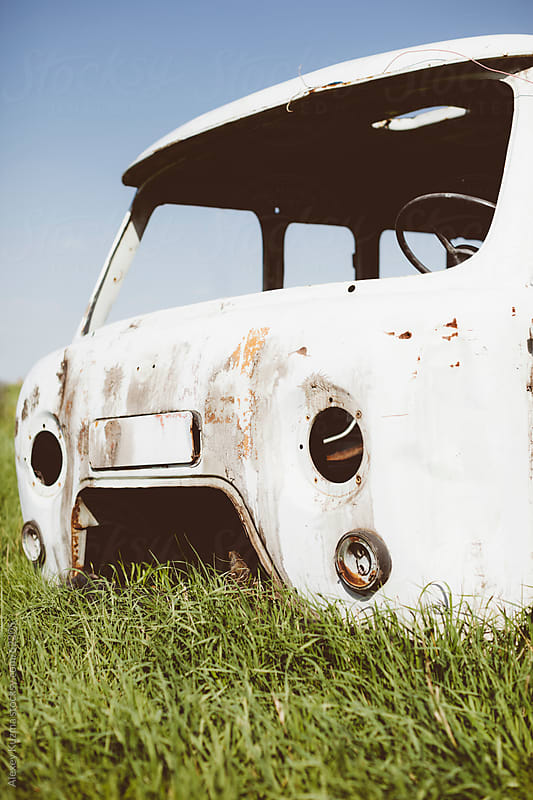 abandoned car by Alexey Kuzma for Stocksy United
