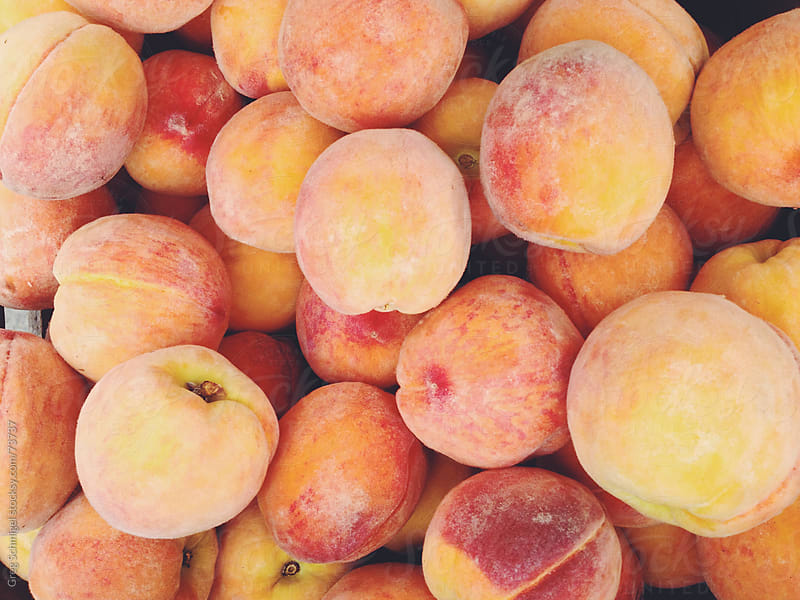Fresh peaches at a summer vegetable market. by Greg Schmigel for Stocksy United