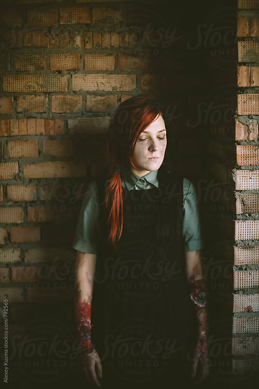 halloween portrait of young woman, natural light  by Vesna for Stocksy United