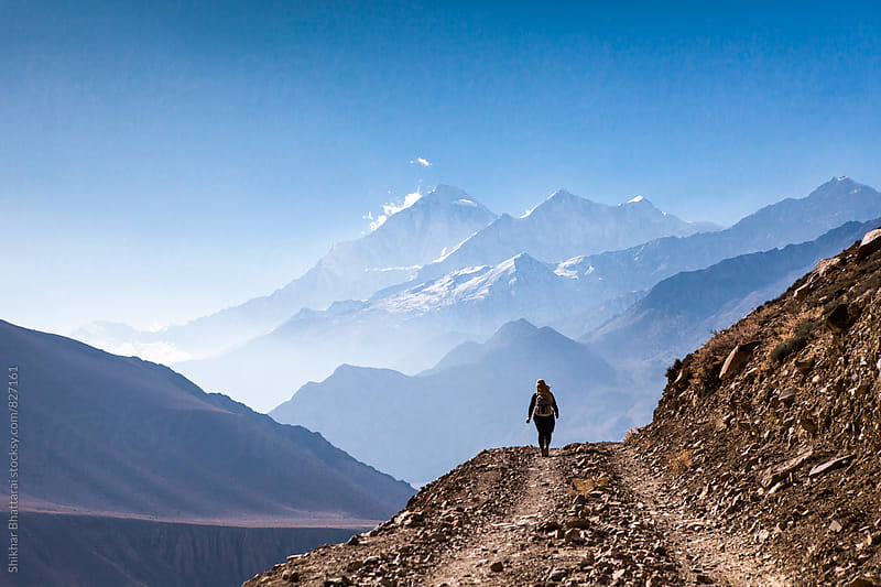 Woman walking in the himalayas. by Shikhar Bhattarai for Stocksy United