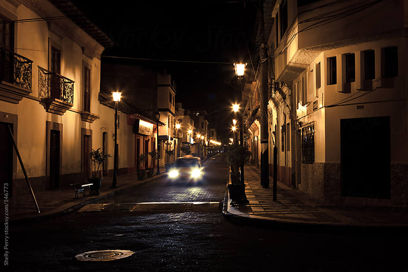 Taxi in Ecuadorian town of Cotacachi at night by Shelly Perry for Stocksy United