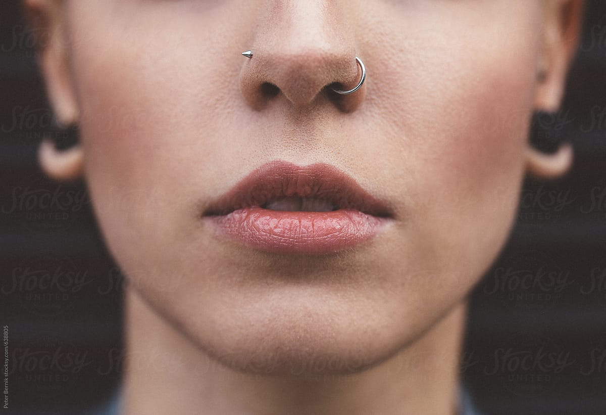 Close Up Of Young Woman With Nose Piercings Stocksy United
