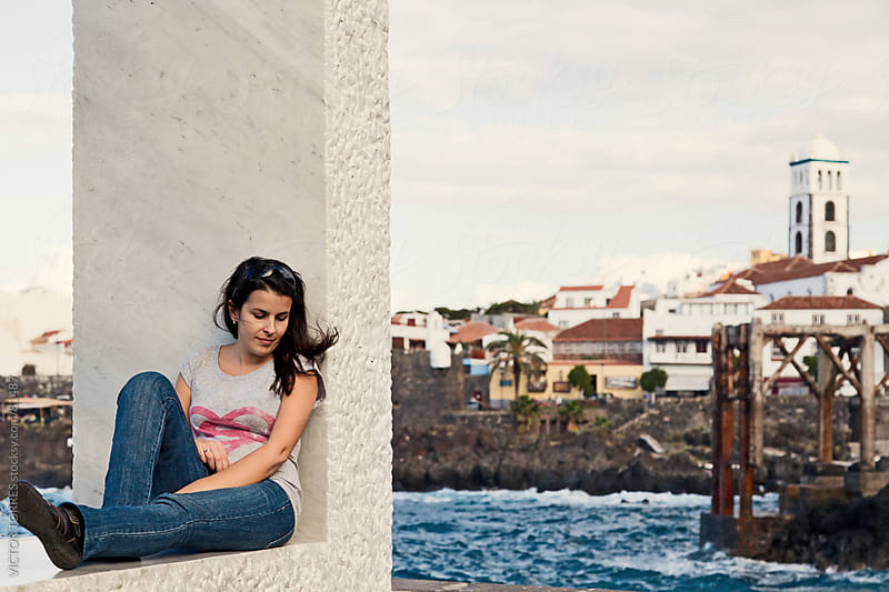 Young Girl Relaxing in Garachico Town, Tenerife by VICTOR TORRES for Stocksy United