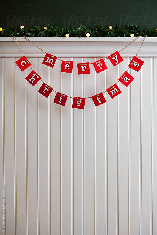 Holidays:  Merry Christmas Sign On Twine by Sean Locke for Stocksy United