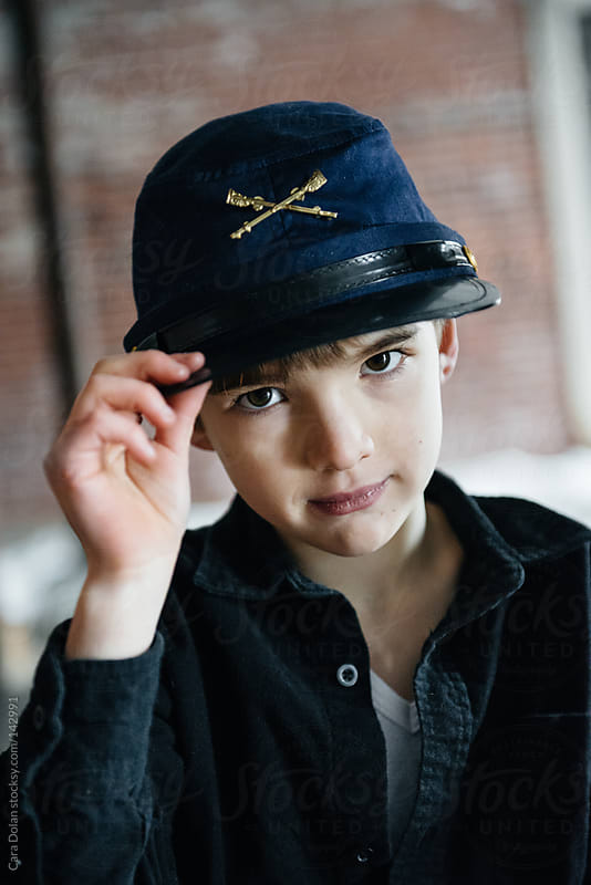 Boy wearing Union soldier hat by Cara Dolan for Stocksy United