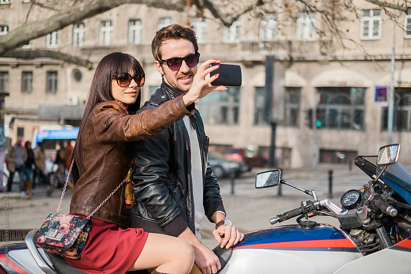 Couple Taking Selfie on the Motorbike by Mosuno for Stocksy United
