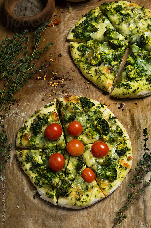 Food: two vegetarian pizzas by Pixel Stories for Stocksy United