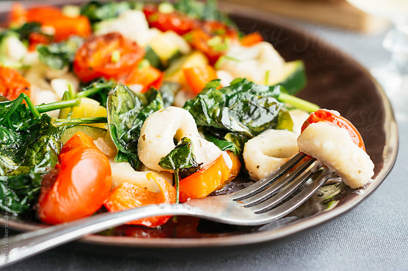 Vegan Creamy Tortellini with Fresh Vegetables by Harald Walker for Stocksy United
