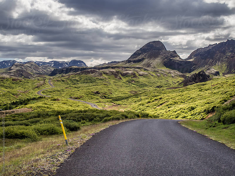 Road leading through Mountains in Iceland by Andreas Wonisch for Stocksy United