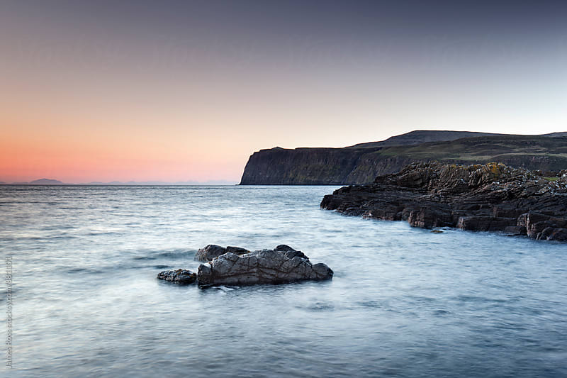 Cliffs and the sea at sunset by James Ross for Stocksy United