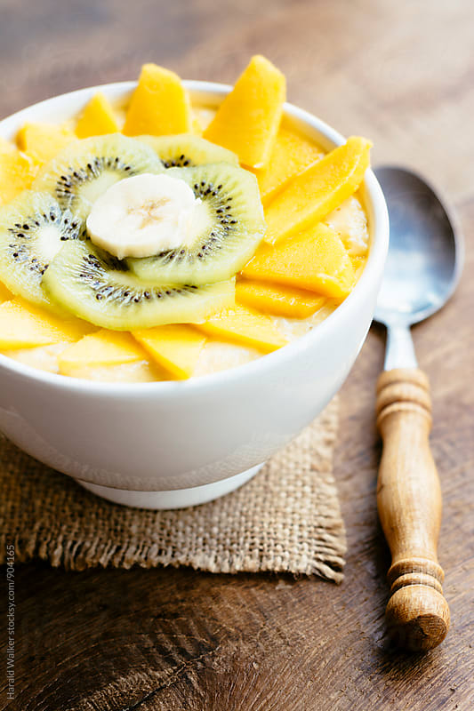 Mango, Kiwi, Banana Smoothie Bowl by Harald Walker for Stocksy United