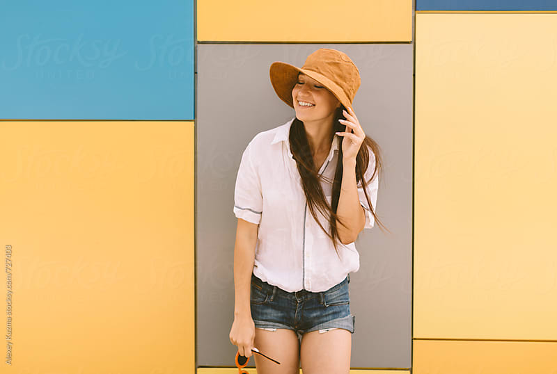 happy summer portrait of young woman with hat by Alexey Kuzma for Stocksy United