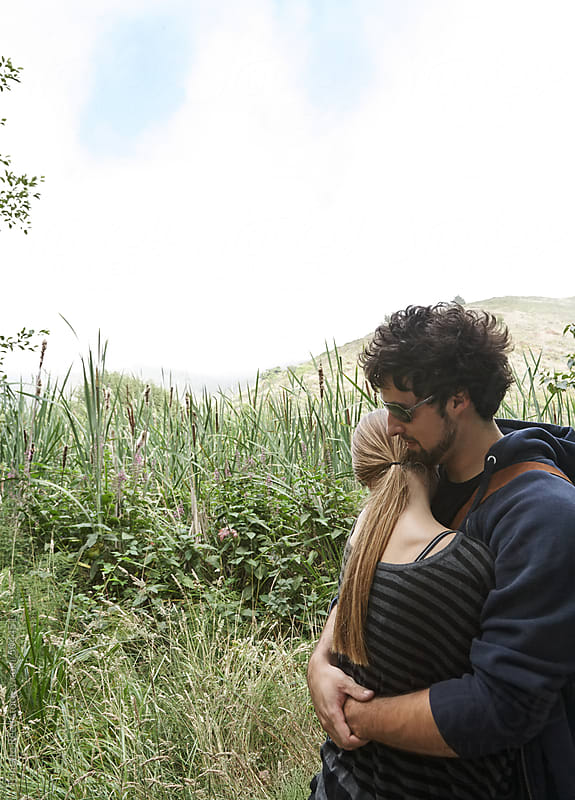 Couple hugging in nature in California  by Trinette Reed for Stocksy United
