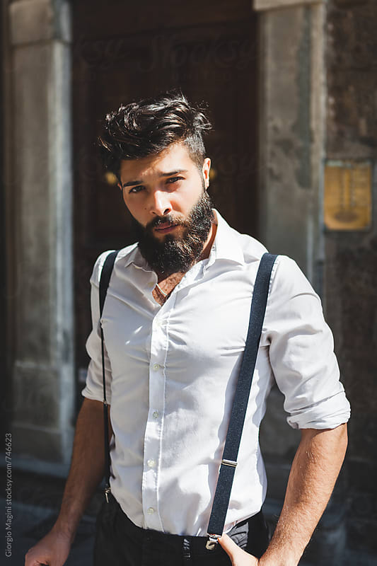 Attractive Young Italian Man with Black Beard Looking at Camera by Giorgio Magini for Stocksy United