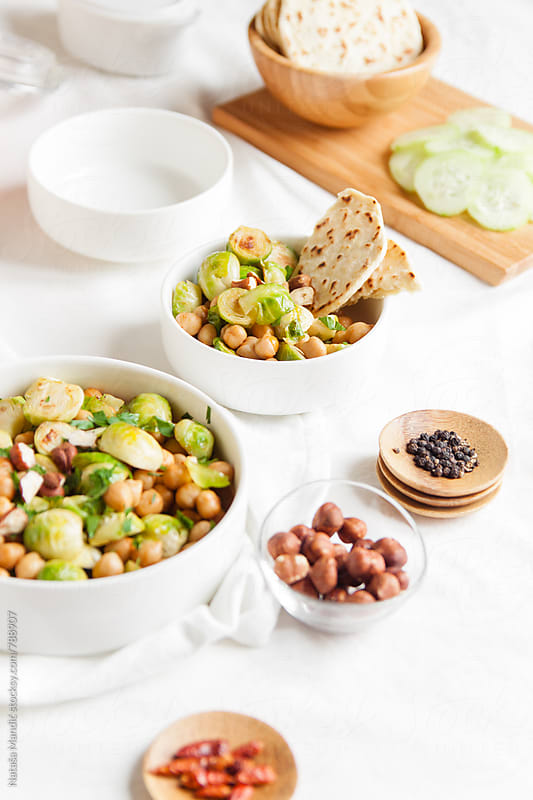 Delicious salad with roasted chickpeas and brussels sprouts by Nataša Mandić for Stocksy United