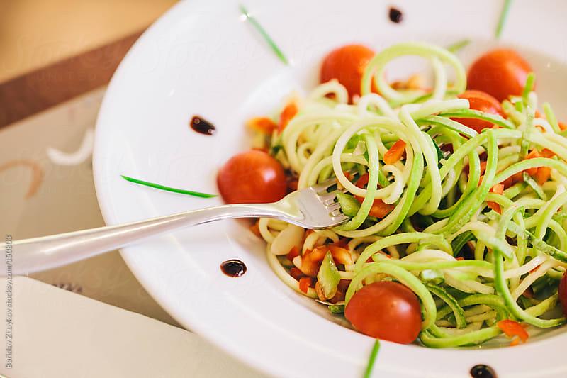 Zucchini Spaghetti with cherry tomatoes and pistachio by Borislav Zhuykov for Stocksy United