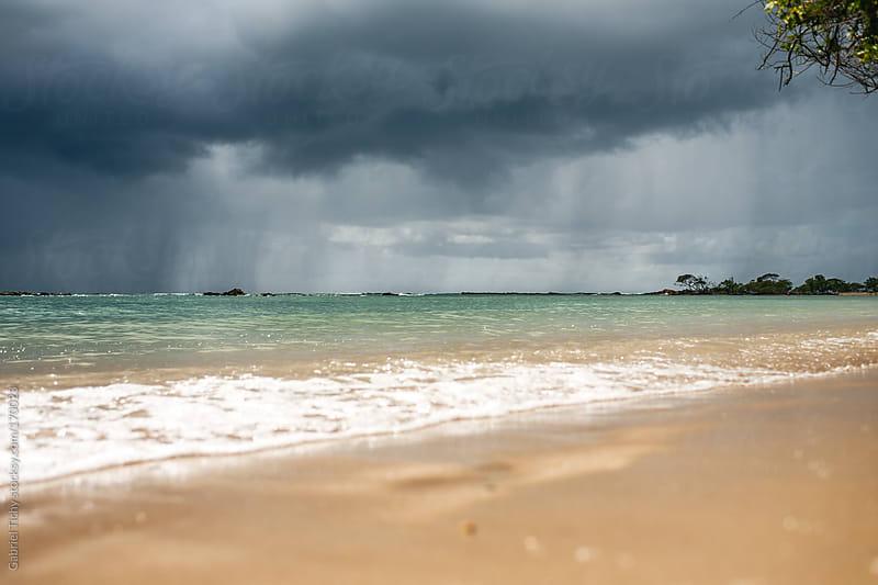 Storm approaching a beach by Gabriel Tichy for Stocksy United