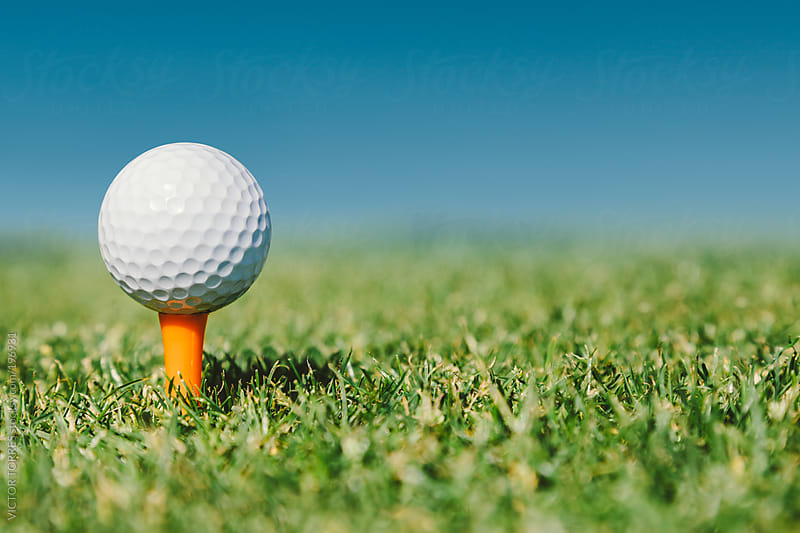Golf Ball in an Orange Tee by VICTOR TORRES for Stocksy United