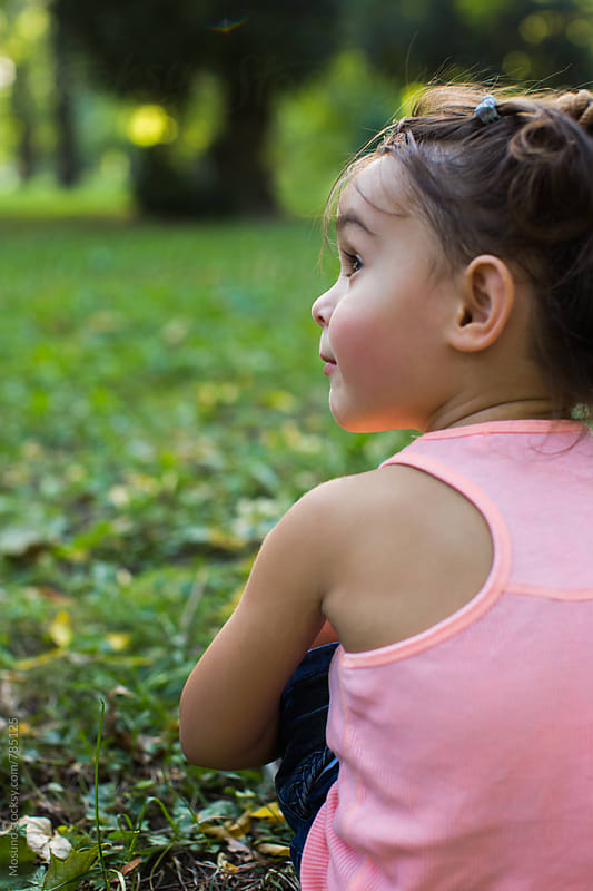 Child Sitting in the Park by Mosuno for Stocksy United