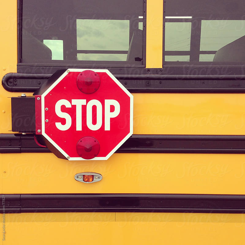 School Bus: Stop Sign on Side of Bus by Sean Locke for Stocksy United