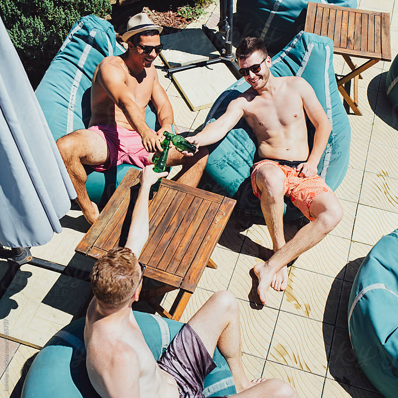 Men Enjoying Beer by the Pool by Lumina for Stocksy United