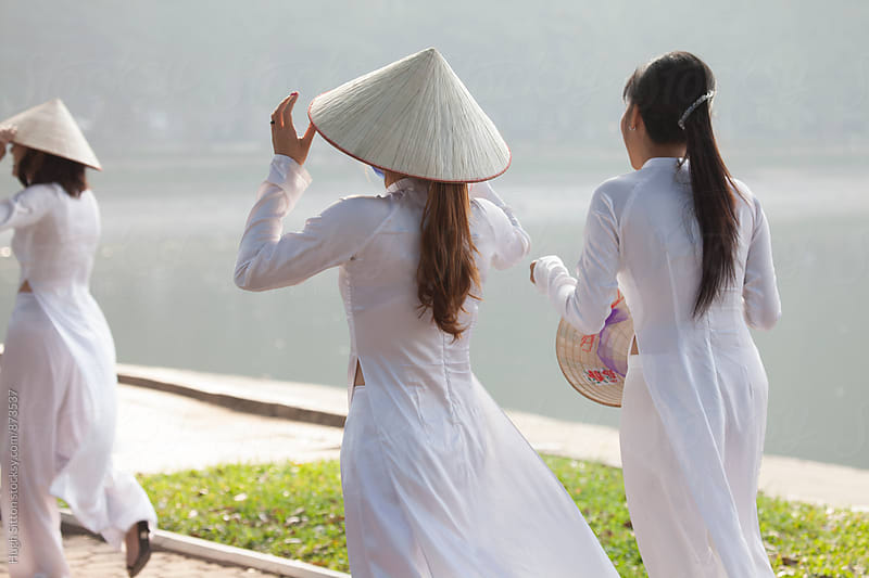 Vietnamese women in traditional costume. Vietnam. by Hugh Sitton for Stocksy United