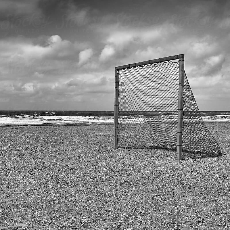 Soccergoal on the beach by Marcel for Stocksy United