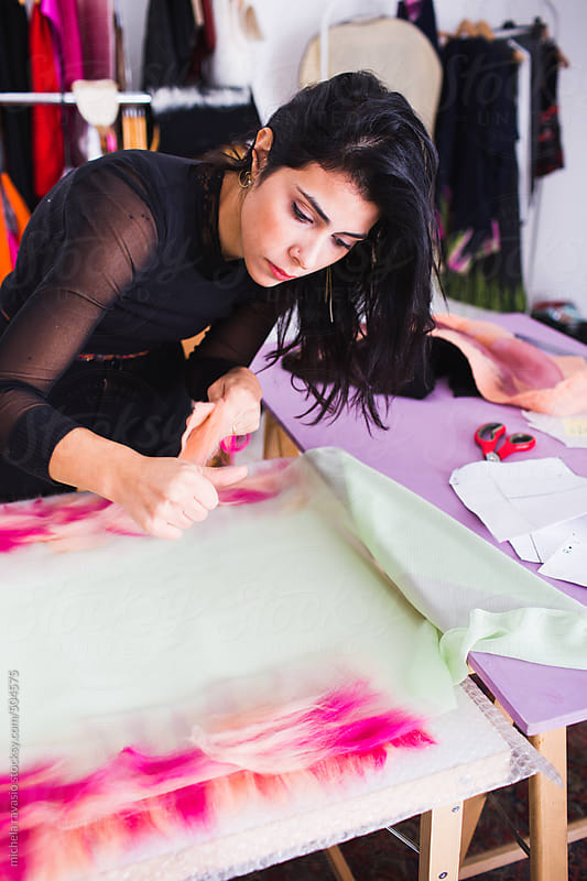 Young fashion stylist woman creating a wool and silk scarf  by michela ravasio for Stocksy United