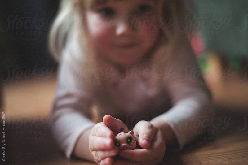 Little girl and her toy. by Cherish Bryck for Stocksy United