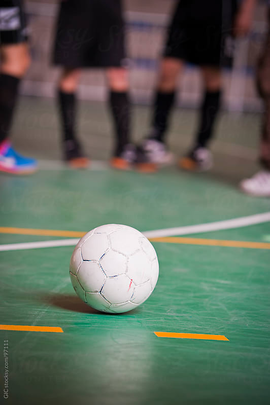 Ball against a group of soccer players  - Stock Image by GIC for Stocksy United