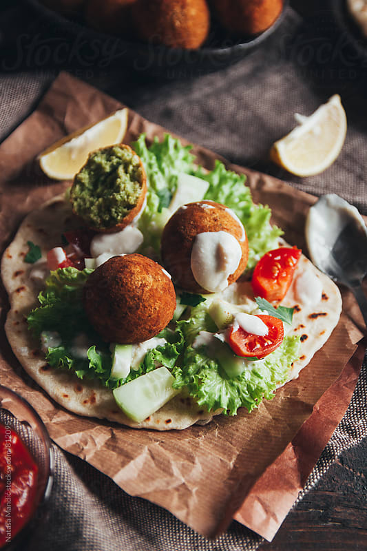Taco with chickpea falafel and salad by Nataša Mandić for Stocksy United