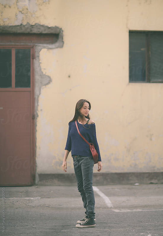 Casual young  woman on the street. by Nabi Tang for Stocksy United